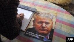 Slika Slobodana Miloševića na plakatu