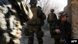 French soldiers take part in a patrol near Tagab in Kapisa Province in January 2010.
