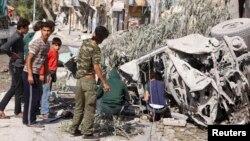Սիրիա - Հալեպի արվարձաններից մեկը կառավարական ուժերի կողմից ռմբակոծությունից հետո, հոկտեմբեր, 2014թ․