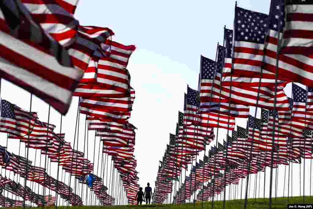 Students walk around Pepperdine University's annual display of flags honoring the victims of the September 11, 2001, terrorist attacks in Malibu, California. (AP/Jae C. Hong)