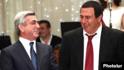 Armenia - President Serzh Sarkisian (L) and Prosperous Armenia Party leader Gagik Tsarukian attend an official celebration in Yerevan.