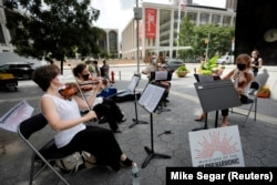 Первое после закрытия концернтных залов публичное выступление струнного квартета Нью-Йоркскго филармонического оркестра