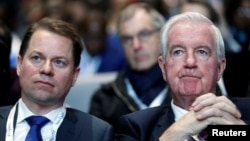 Craig Reedie (right), president of the World Anti-Doping Agency, and Olivier Niggli, its director-general (file photo)
