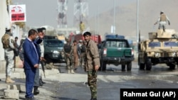 Afghan soldiers inspect the site of a suicide attack near the election commission office in Kabul on October 29.