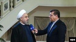 Роухани мамлекеттик телеге интервью берүүдө. Тегеран, 24-ноябрь, 2014-жыл.