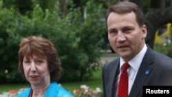 Poland is propsoing Foreign Minister Radoslaw Sikorski (right) succeed EU foreign-policy chief Catherine Ashton in December.