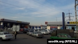 Uzbekistan - people are staying in a queue to refuel cars in Tashkent, 4 November 2013