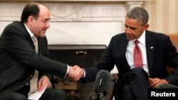 Iraqi Prime Minister Nuri al-Maliki (left) shakes hands with U.S. President Barack Obama after a meeting at the White House in Washington in November.