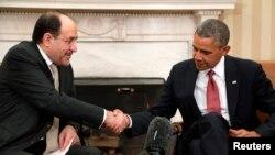 ABŞ-nyň prezidenti B.Obama (s) we Yragyň premýer-ministri N.al-Maliki (ç) Waşington, 2013.