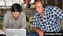 Doctor Gregory Anderson (left) works with Middle Chulym-speaker Vasiliy Gabov (courtesy of The Living Tongues Institute For Endangered Languages)