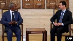 Syria -- President Bashar al-Assad meets with UN-Arab League envoy Kofi Annan (L) in Damascus, 09Jul2012