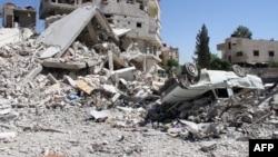 Սիրիա - Ավերածություններ մայրաքաղաք Դամասկոսի թաղամասերից մեկում, հունիս, 2013թ.