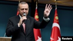 Turkish President Tayyip Erdogan addresses the nation in a live television broadcast from the presidential palace in Ankara on July 21.