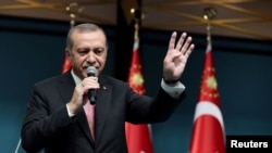 Turkish President Tayyip Erdogan addresses the nation in a live television broadcast from the presidential palace in Ankara, Turkey on July 21.