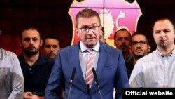VMRO-DPMNE leader Hristijan Mickoski speaks at a press conference at party headquarters in Skopje on September 11.
