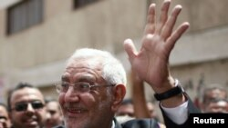 Presidential candidate Abdel Moneim Abul Fotouh waves after casting his vote at a polling station in Cairo. A Fotouh presidency could present a challenge to the ruling military council.