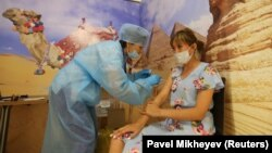 A woman receives a dose of the Sputnik V vaccine in a shopping mall in Almaty.