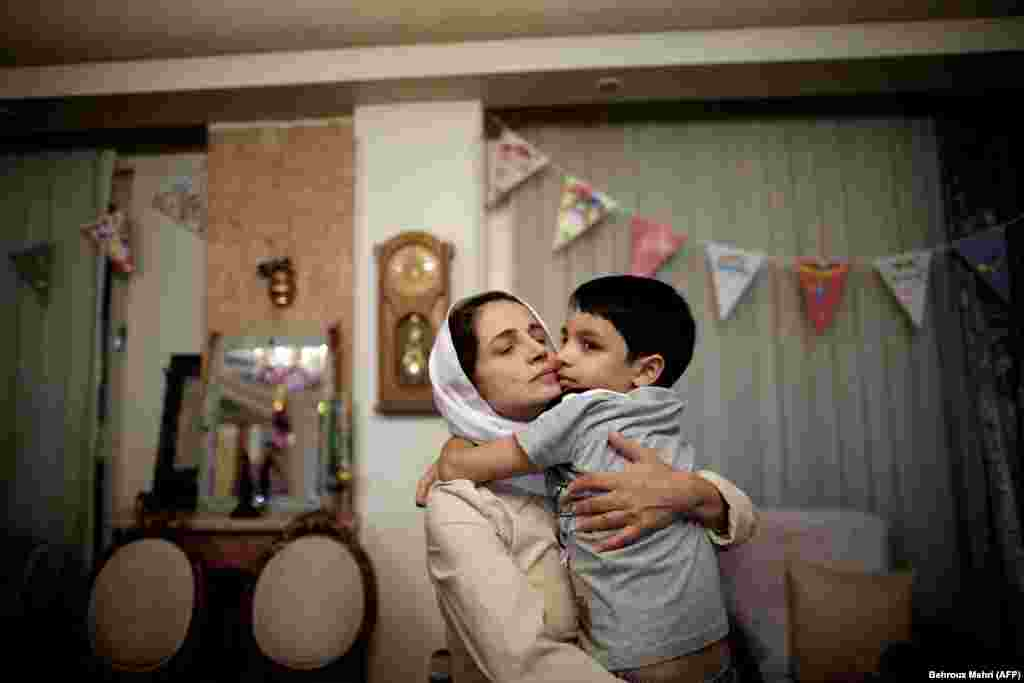 Iranian lawyer Nasrin Sotoudeh hugs her son Nima at her home in Tehran. (AFP/Behrouz Mehri)