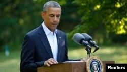ԱՄՆ նախագահ Բարաք Օբաման հայտարարությամբ է հանդես գալիս, Մարթաս Վայնյարդ, Մասաչուսեթս, 11-ը օգոստոսի, 2014թ․