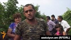 Armenia - A farmer in Paravakar village talks to RFE/RL, 1Oct2015.