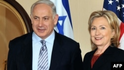 U.S. Secretary of State Hillary Rodham Clinton with Israeli Prime Minister Binyamin Netanyahu at the State Department on March 22.