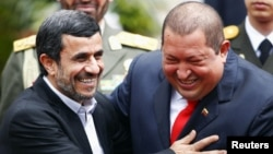 Iran's President Mahmud Ahmadinejad (left) is welcomed by Venezuela's President Hugo Chavez in Caracas in January 2012.