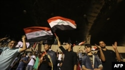Supporters of cleric Muqtada al-Sadr gather in after breaking into Baghdad's heavily fortified Green Zone.