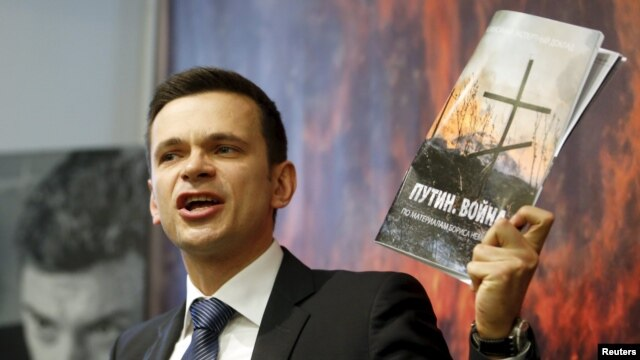 Russian opposition activist Ilya Yashin speaks to the media during a presentation of the report about the Russian military presence in Ukraine that murdered opposition leader Boris Nemtsov was working on shortly before his death, in Moscow on May 12.