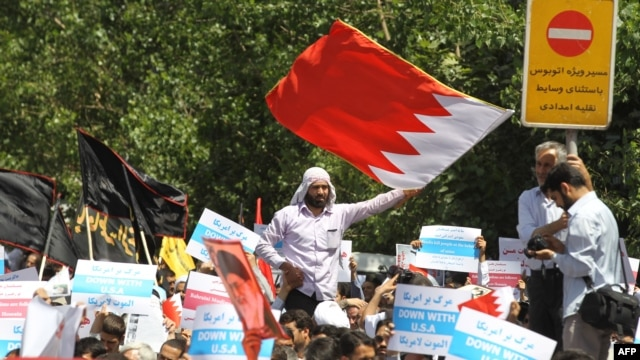 Demonstrators wave Bahraini flags during a protest after Friday prayers on May 18 in Tehran against alleged plans for a union between Saudi Arabia and Bahrain