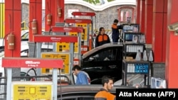 Iranian drivers fill their tanks at a gas station in the capital Tehran, November 5, 2018