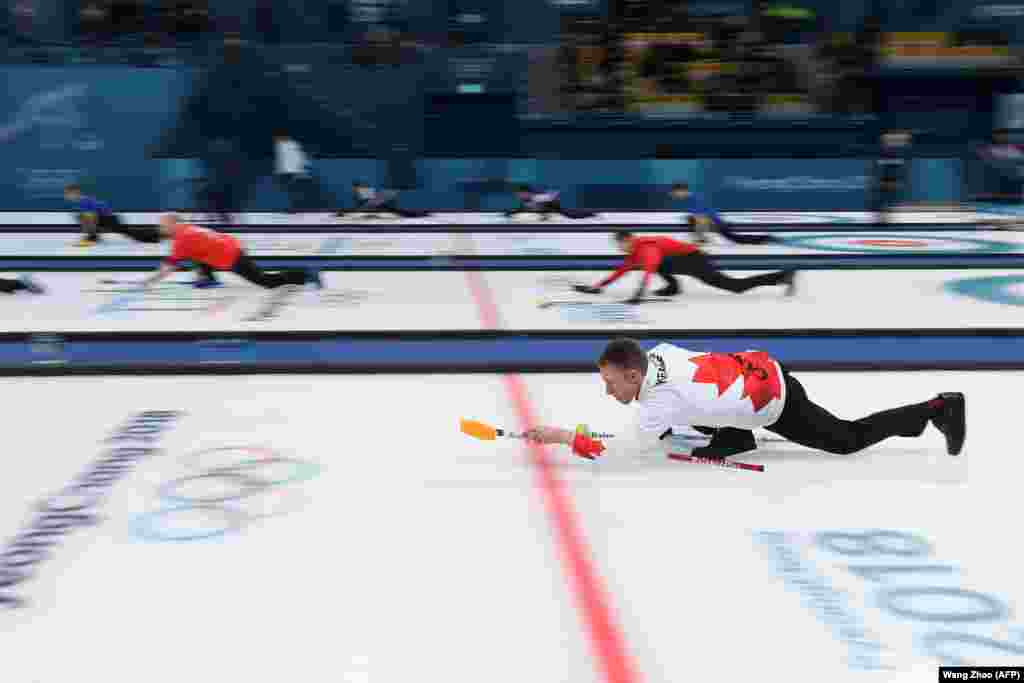 Curling: Canada's Marc Kennedy practices before the curling men's round robin session between Denmark and Canada during the Pyeongchang 2018 Winter Olympic Games at the Gangneung Curling Centre in Gangneung on February 21, 2018.