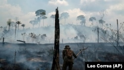 BRAZIL -- A Brazilian soldier puts out fires at the Nova Fronteira region in Novo Progresso, Brazil, Tuesday, Sept. 3, 2019.
