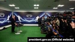 Ukrainian President Petro Poroshenko speaks to journalists at the Olimpiyskiy Stadium in Kyiv on April 10.