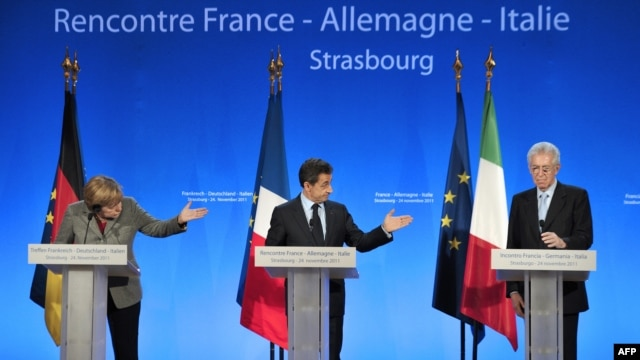German Chancellor Angela Merkel (left), French President Nicolas Sarkozy (center) and Italian Prime minister Mario Monti attend a press conference during a European mini-summit on the debt crisis in Strasbourg, France.