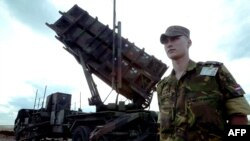 A Dutch soldier stands beside a Patriot antimissile battery at the Diyarbakir military airport in southeastern Turkey in 2003, when Patriots were deployed during the U.S.-led coalition's invasion of neighboring Iraq.