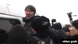 One of the antidevaluation protesters is detained by police in Almaty on February 15.