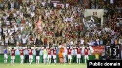 Ақтөбе стадионындағы футбол матчы. Көрнекі сурет.