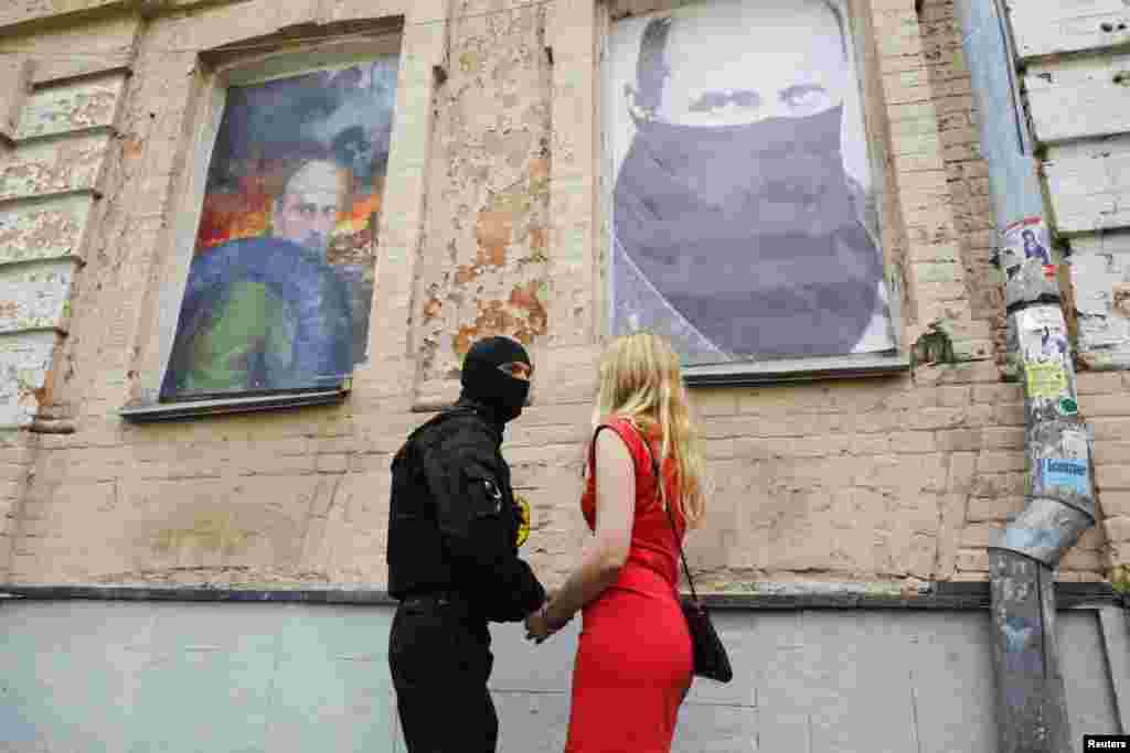 "A fighter of Social Nationalist Assembly, part of ultranationalist Right Sector party, says farewell to his girlfriend before heading to eastern Ukraine as part of the ""Azov"" battalion during a ceremony in their headquarters in Kyiv, on June 3. (Reuters/Valentyn Ogirenko)"