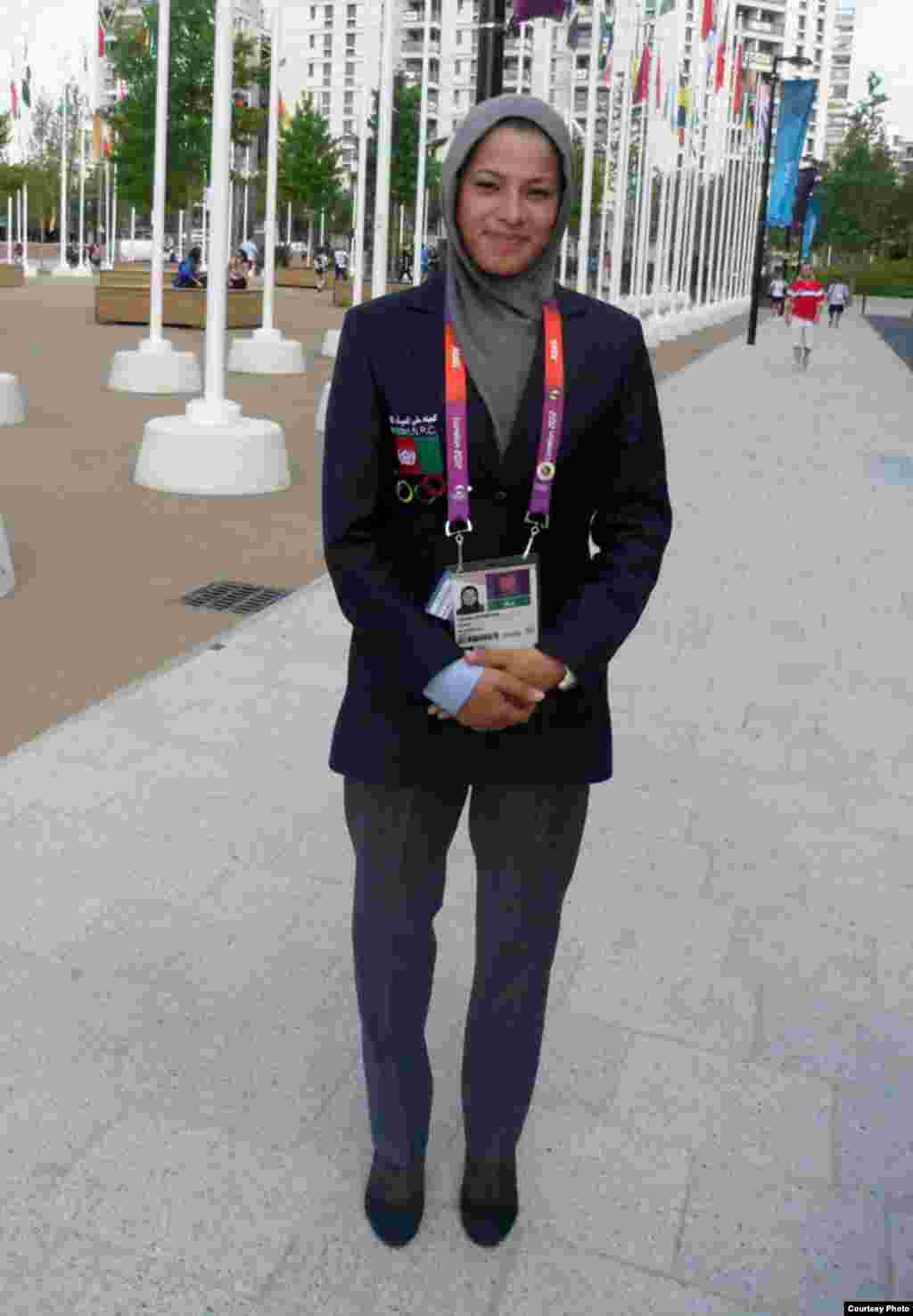 Afghan sprinter Tahmina Kohestani wears the team's simple suit before the Games -- but for the Opening Ceremony, she's expected to be the only team member in Afghan national dress.