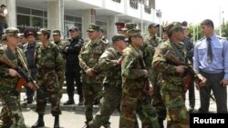 Kyrgyz security forces in Osh try to stabilize the situation in the southern city on May 14.