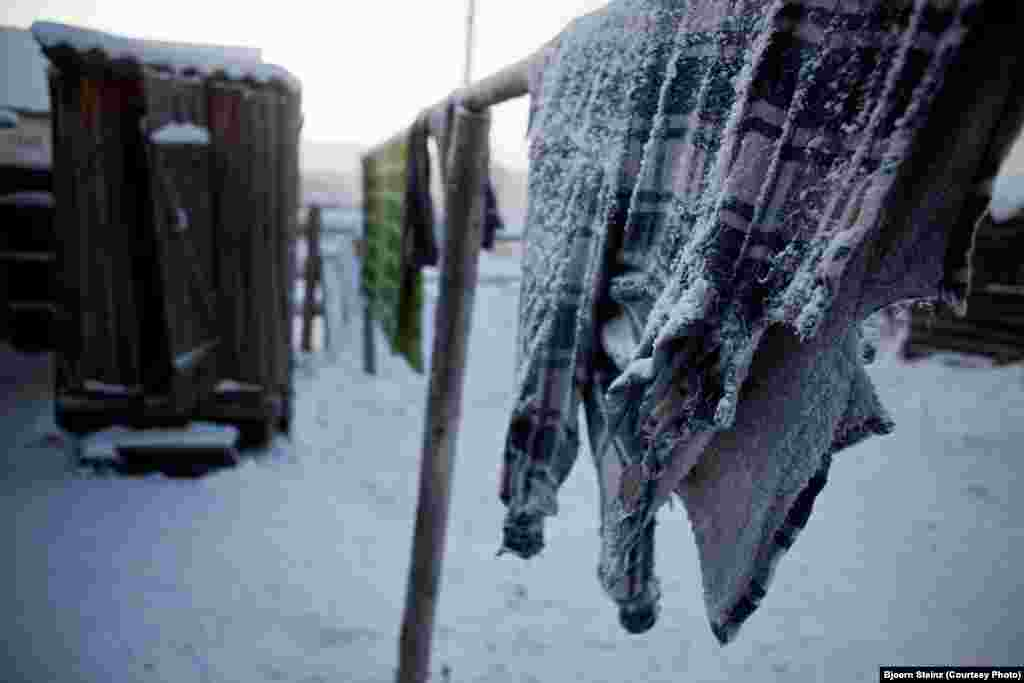 Frozen clothes hang on the line in Oymyakon.