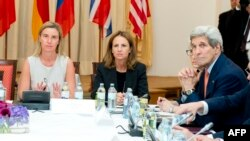 European Union foreign policy chief Federica Mogherini (left) and U.S. Secretary of State John Kerry (right) meet on July 7 at the Palais Coburg Hotel in Vienna, where the Iran nuclear talks meetings are being held.