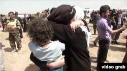 Yazidis receive aid in Kirkuk after they were released by Islamic State militants.