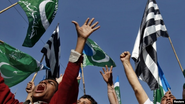 Supporters of Islamic parties hold party flags and shout slogans as they demand punishment for Aasia Bibi, the Christian woman sentenced to death for blasphemy, at a rally in Karachi last month.