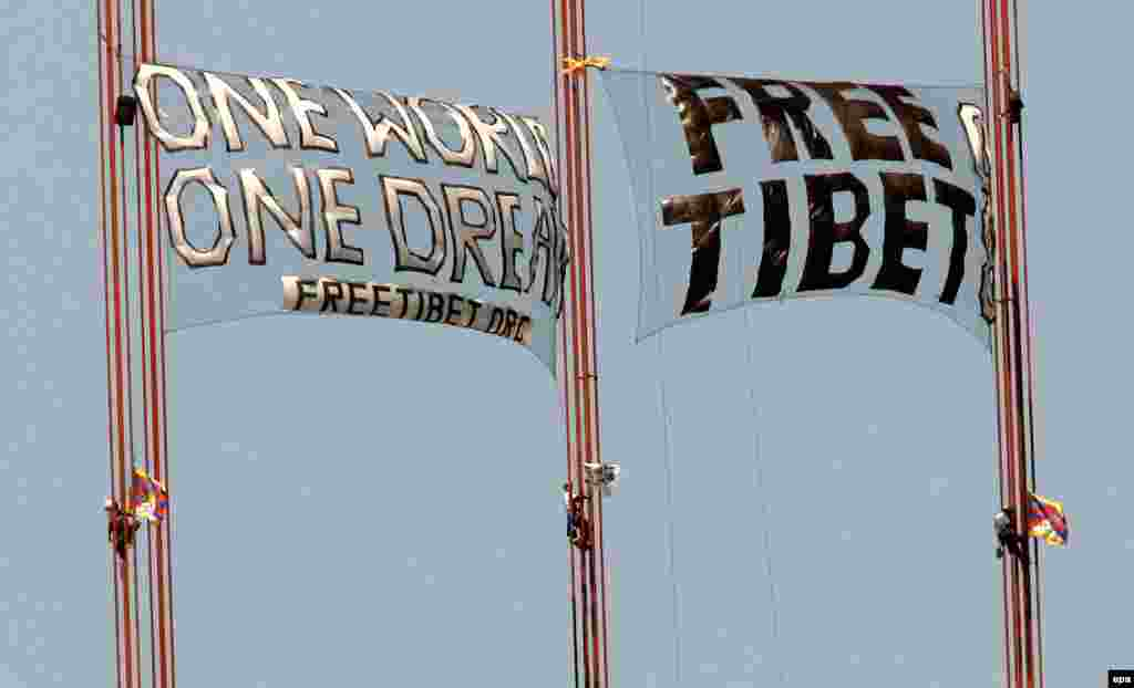 "Three demonstrators scale the Golden Gate Bridge to unfurl two ""Free Tibet"" banners in San Francisco, California, where the torch relay took an undisclosed route, in April 2008."