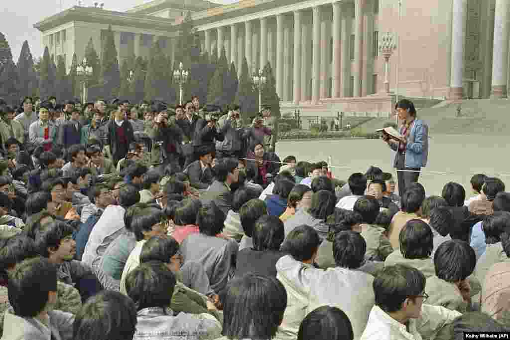 In this April 18, 1989 file photo, a Chinese student leader reads a list of demands to students staging a sit-in in front of Beijing's Great Hall of the People. A quarter century after the Communist Party's attack on demonstrations centered on Tiananmen Square on June 4, 1989, the ruling party prohibits public discussion and 1989 is banned from textbooks and Chinese websites. (AP Photo/Kathy Wilhelm)