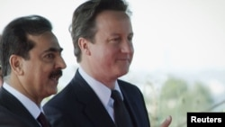 Pakistani Prime Minister Yusuf Raza Gilani (left) welcomes his British counterpart, David Cameron, to Islamabad today.