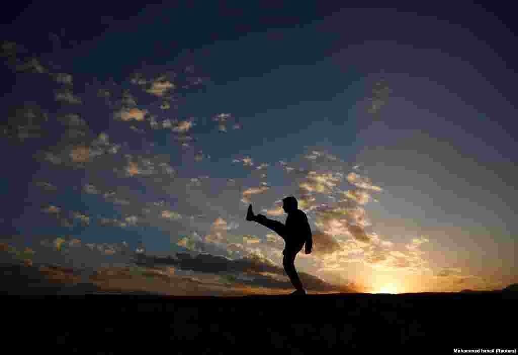 An Afghan man exercises in the early morning on a hilltop in Kabul. (Reuters/Mohammad Ismail)