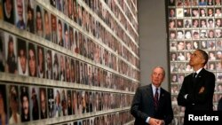 U.S. -- President Barack Obama (R) and former New York Mayor Michael Bloomberg look at the faces of those who died during the 9/11 attacks at the National September 11 Memorial Museum in New York, May 15, 2014