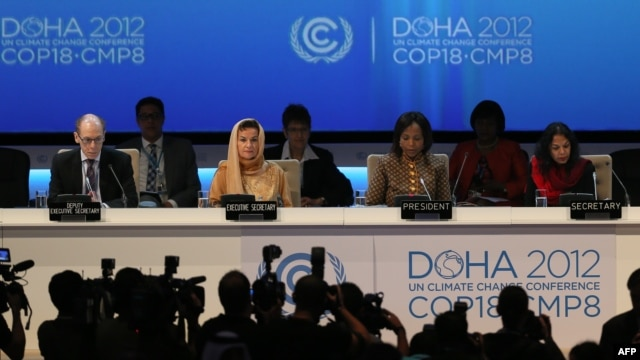 Delegates at the opening ceremony of the 18th United Nations climate change conference in Doha on November 26.